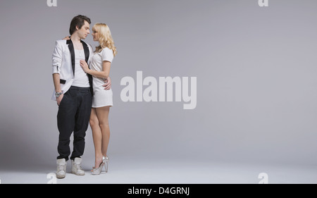 Beloved young couple presenting their feelings - Stock Photo