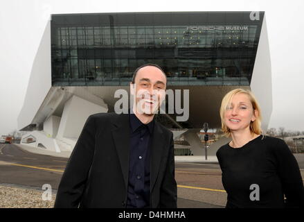 Architects Roman Delugan (L) and his wife and business partner Elke Delugan-Meissl (R) pose outside the building - Stock Photo