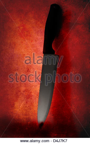 Knife used as a weapon has got blood on it - Stock Photo