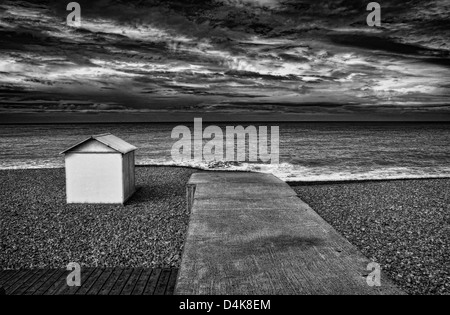 Concrete dock and hut on rocky beach - Stockfoto