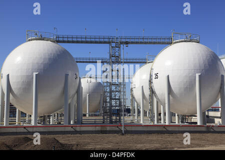 Large oil and gas tanks are pictured in the industrial harbour of Paldiski near Tallinn, Estonia, June 2009. Photo: - Stock Photo