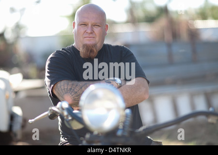 Man sitting on motorcycle - Stock Photo