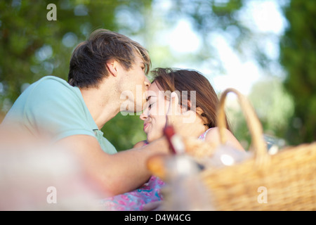 Couple kissing in park - Stock Photo