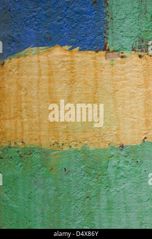 Painted artsy urban background texture with stripes of blue, yellow and green paint on a wooden telephone pole - Stock Photo
