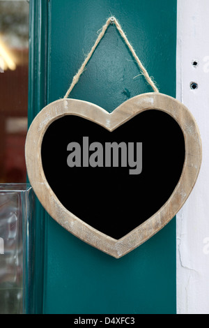 heart with sign closed in window shop - Stock Photo