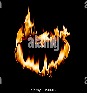 heart shape in fire flame - Stock Photo