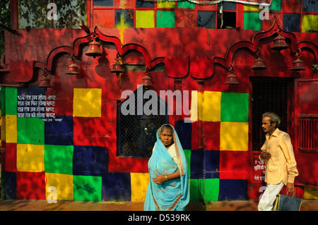 Colorful temple by the street in Old Delhi - Stock Photo