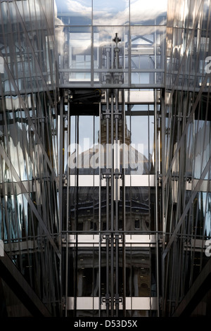 Reflection of St.Paul's Cathedral in the Glass Facade of an office block - Stock Photo