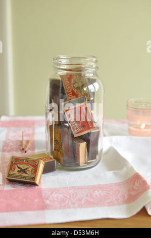 old jar of vintage matchboxes - Stock Photo