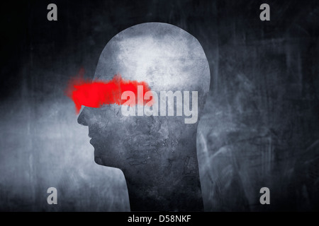 Conceptual image of an abstract head with red paint over the eyes. - Stock Photo