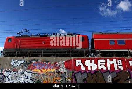 Berlin, Germany, Regional Tram runs over one sprayed with graffiti railway line - Stock Photo