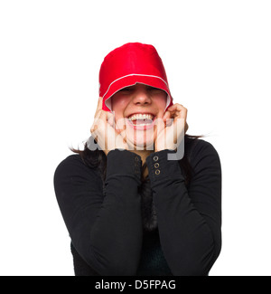 Goofy portrait of a woman wearing a red hat isolated on white background - Stockfoto
