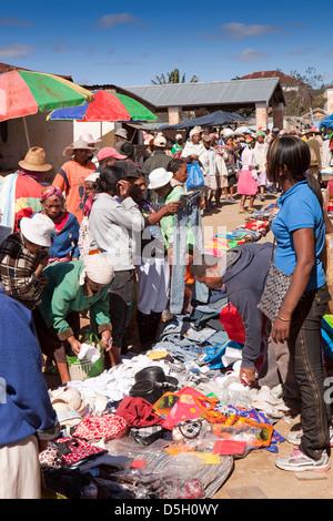 Madagascar, Ambositra, Marche Sandrandahy market, stall selling used European clothes - Stock Photo