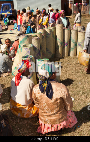 Madagascar, Ambositra, Marche Sandrandahy market, customers at woven matting stall - Stock Photo