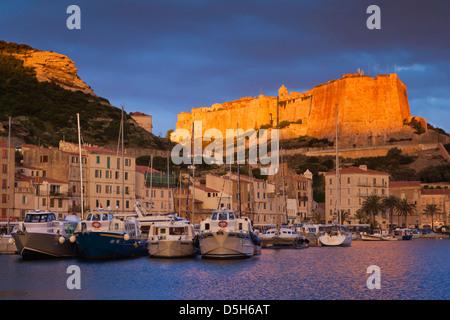 France, Corsica, Bonifacio, port and Citadel, sunrise - Stock Photo