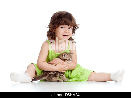 funny little girl playing with Scottish kitten - Stock Photo