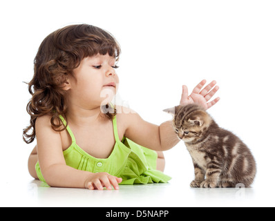 funny happy child playing with cat kitten - Stock Photo