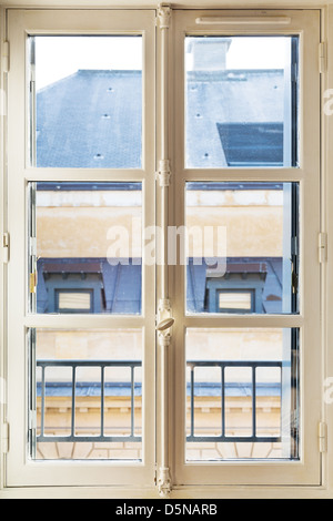 wooden white painted window in room, Paris - Stock Photo
