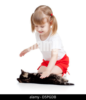 happy child girl playing with cat kitten - Stock Photo