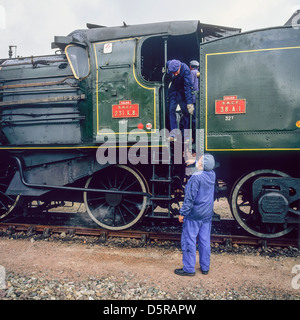 Engineers with historic steam locomotive 'Pacific PLM 231 K 8' of 'Paimpol-Pontrieux' train Brittany France - Stock Photo