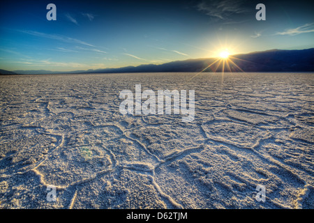 Sunset over salt polygons at Badwater, Death Valley National Park, California, USA - Stock Photo