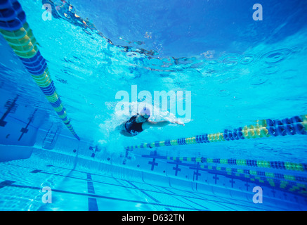 Young female swimmer in competition - Stock Photo