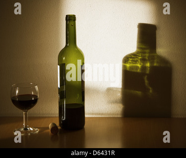 Blttle and glas with shadow - Stock Photo