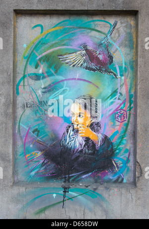 C215 street painting in Oslo girl and bird - Stock Photo