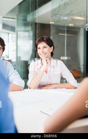 Businesswoman sitting in meeting - Stock Photo