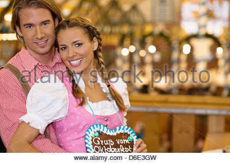 Young couple in traditional Bavarian costume the Oktoberfest Munich Germany - Stock Photo