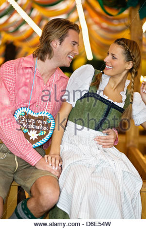 Young couple flirting Oktoberfest beer festival Munich Germany - Stock Photo