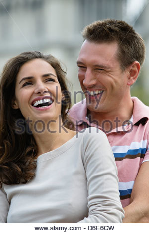 Young couple laughing embracing Paris France - Stock Photo