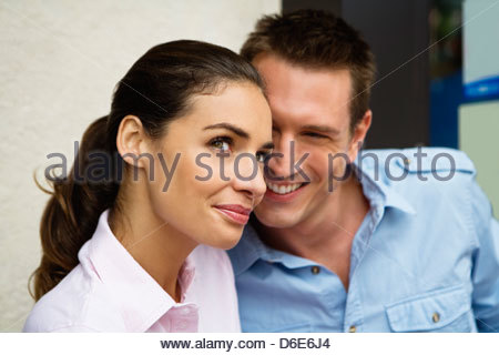 Young couple outside street side cafe Paris France - Stock Photo