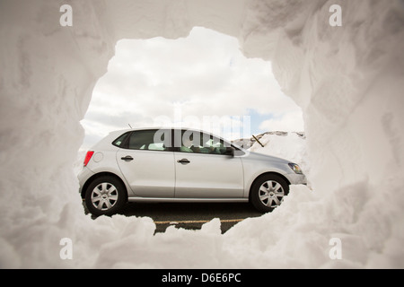 Massive snow drifts on the side of the Kirkstone Pass road above Ambleside in the Lake District, - Stock Photo