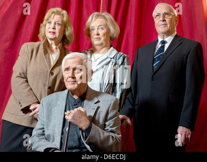 Actor Joachim Fuchsberger sits in front of his wife Gundula (L), his brother Otmar (R) and Otmar's wife Erika (C) - Stock Photo