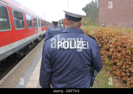 Flensburg, Germany, the federal police at a control in the train of Deutsche Bahn - Stock Photo