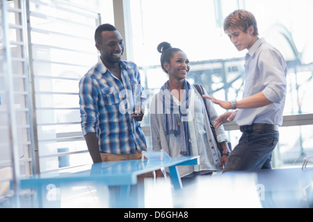 Couple and salesman shopping in store - Stock Photo