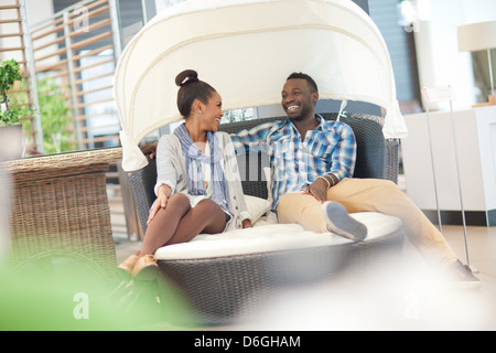 Couple shopping for furniture in store - Stock Photo