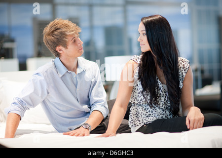 Couple shopping for mattress in store - Stock Photo