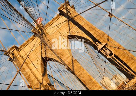 Brooklyn Bridge under blue sky - Stock Photo