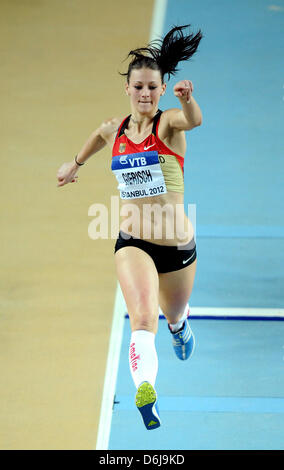 Germanys Kristin Giersch competes in the Women's Triple Jump qualification at the IAAF World Indoor Championships - Stockfoto