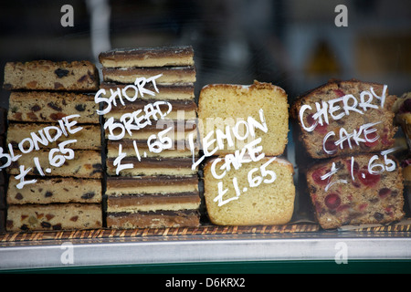 Cakes for sale on a kiosk - Stock Photo