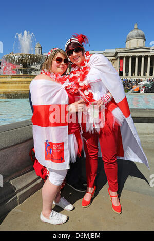 London, UK. 20th April 2013. Two women dressed in England flags and patriotic costumes for St. George's Day Celebrations - Stock Photo