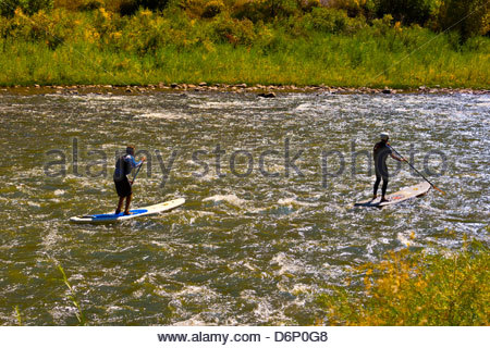 Stand up paddle boarding on the Colorado River in Glenwood Canyon, near Glenwood Springs, Colorado USA - Stock Photo