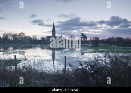 Salisbury Cathedral at dawn reflected in the flooded West Harnham Water Meadows, Salisbury, Wiltshire, England, - Stock Photo