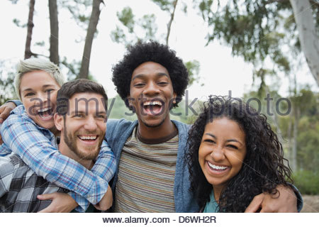 Portrait of friends laughing together outdoors - Stock Photo