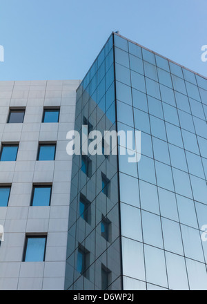 Abstract modern building detail background with sky color reflection - Stock Photo