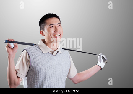 Portrait of young golf player - Stock Photo