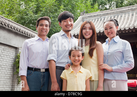Three Generation Family in a Courtyard - Stock Photo