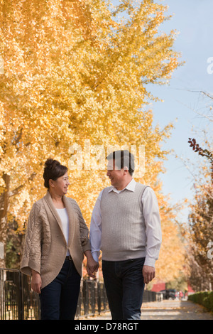Mature Couple Walking in the Park - Stock Photo